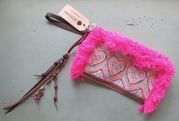 An absolutely stunning JADEtribe neon pink fringe clutch.  The accessory of the summer...